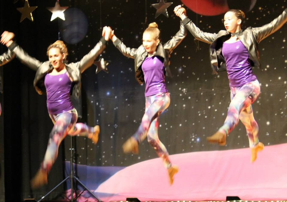 girls jumping in recital